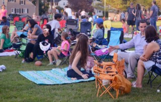 Families stake out some good spots for the movie following the Party in the Park.