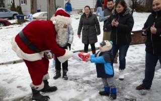Santa delivers Patrick K's gift on Shady Lane